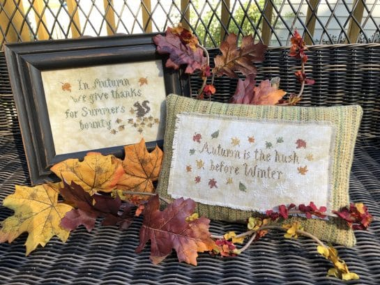 Photo of finished Autumn Smalls set by Falling Star Primitives, displayed on wicker bench with Autumn leaves